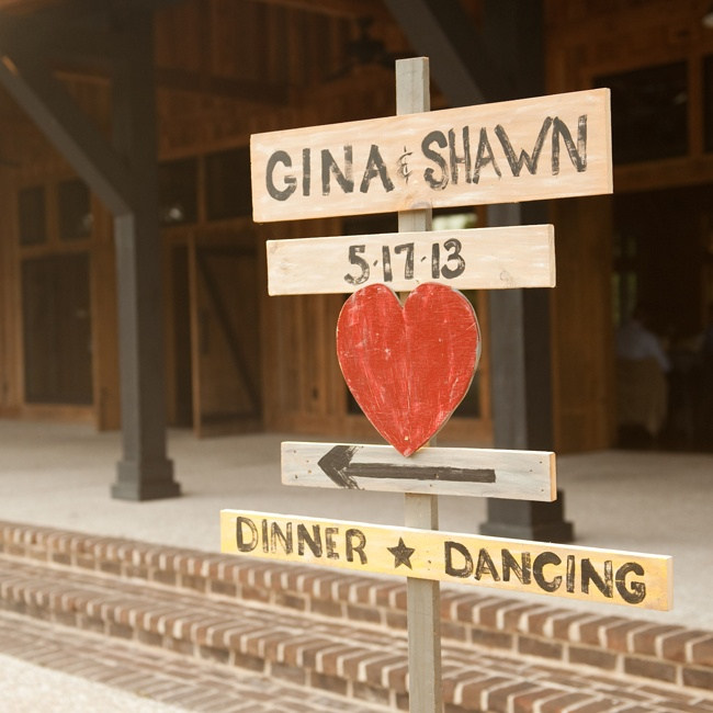 Painted wooden signs pointed guests in the direction of the reception.