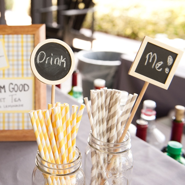 Guests sipped their drinks through fun stripey yellow and gray straws.
