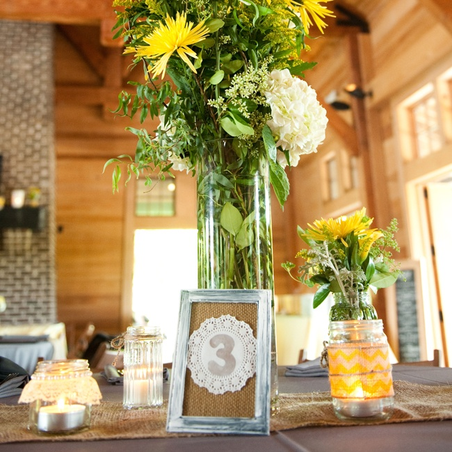 The table numbers had a shabby chic feel with distressed frames, burlap mats and painted doilies.