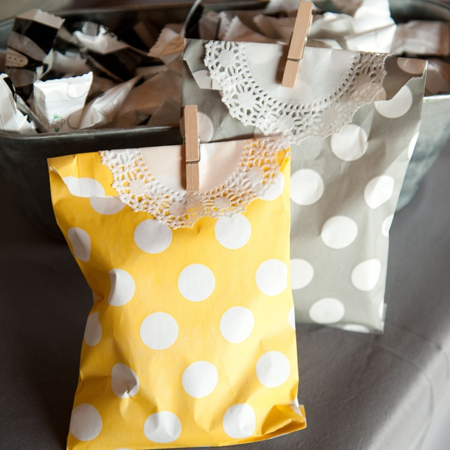 The favors were wrapped in yellow and gray polka-dotted bags and sealed with clothespins.