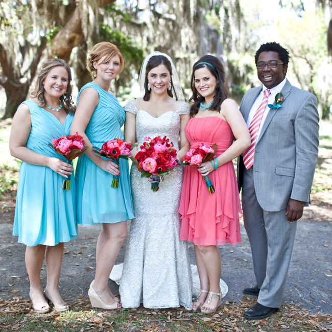 Britt's bridesmaids wore bright blue and pink dresses, while her attendant wore a light gray suit with a pink and white tie to complement the cheerful color palette.