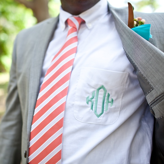 The groomsmen's white dress shirts were customized with their monograms in Tiffany blue stitching.