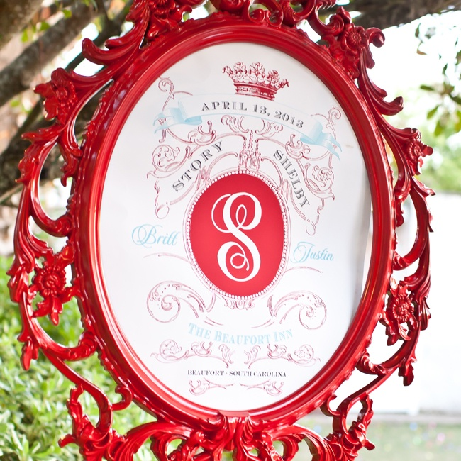 An elaborate red frame displayed a welcome sign with a regal motif that matched the couple's invitations.