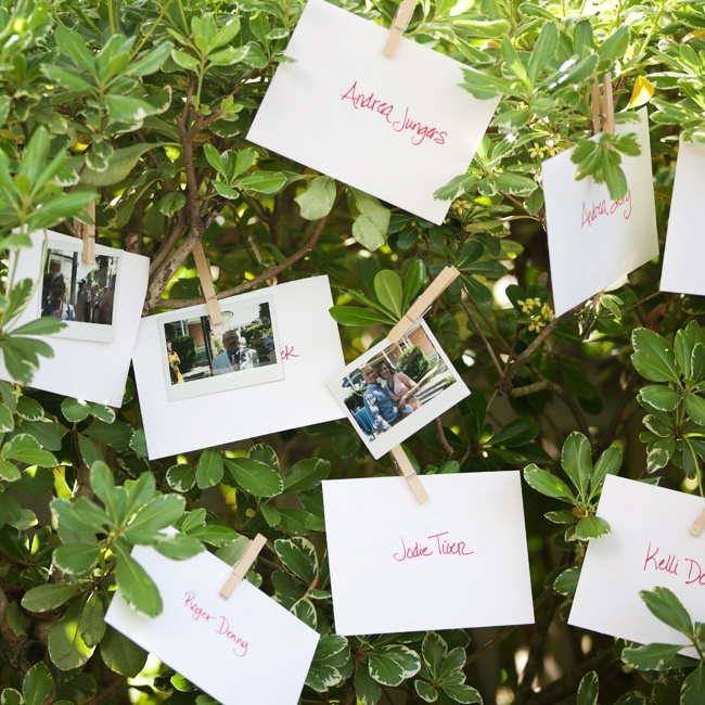 The escort cards were handwritten thank you notes the couple wrote to each guest. The notes were in envelopes pinned to the hedges during the cocktail hour and guests replaced them with a picture of themselves.