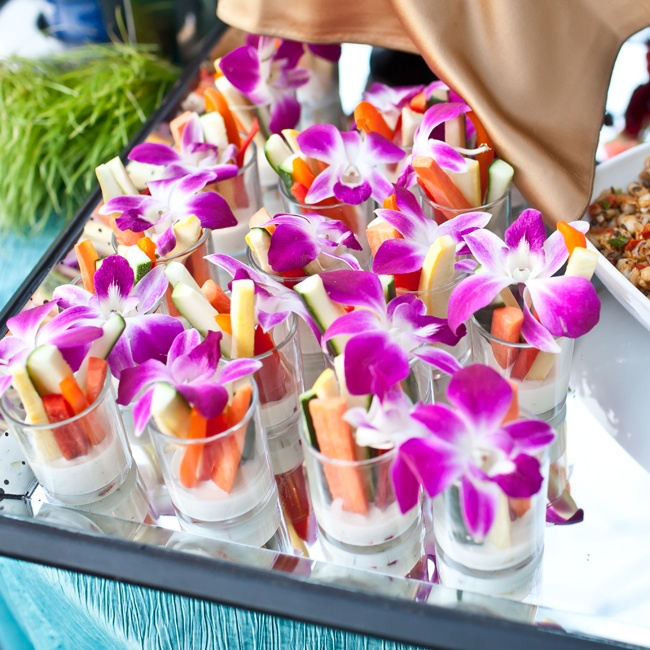 Fresh vegetable cups decorated with a bright purple orchid were passed during cocktail hour.