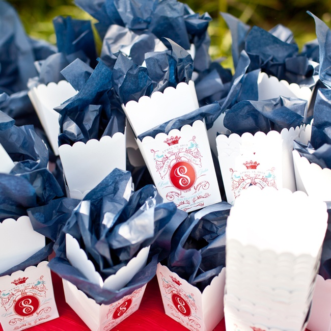The popcorn-style favor boxes were printed with the same regal monogram featured on the couple's invitations.