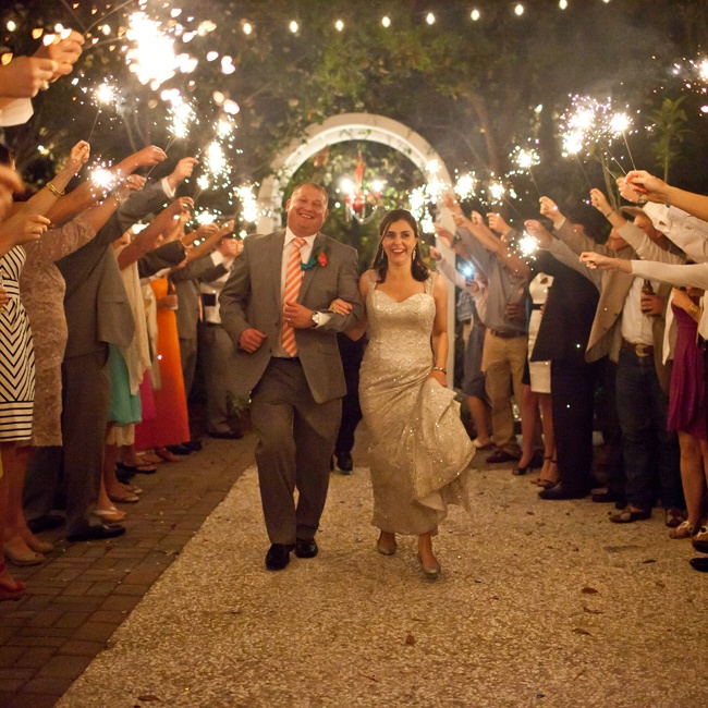 The couple made their exit passing through a tunnel of bright sparklers.