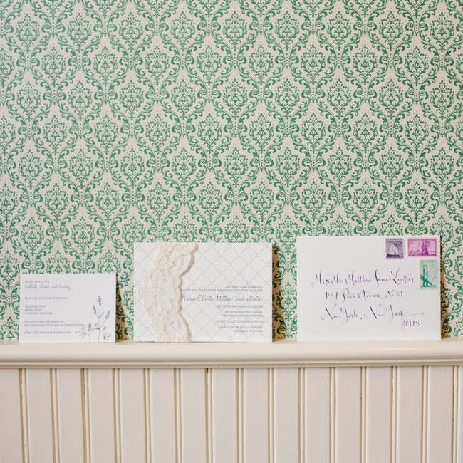 The couple's letter pressed invitation set was accented with purple color and lace details.