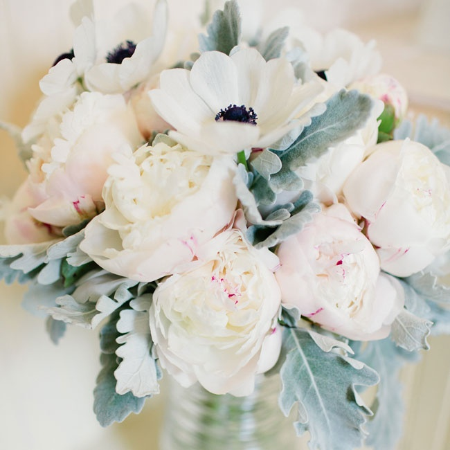 The bride's bouquet was filled with lamb's ear leaves, white anemones and peonies.