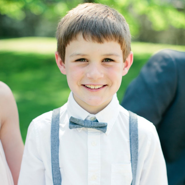 This ring bearer wore chambray suspenders with a matching bowtie for the festivities.