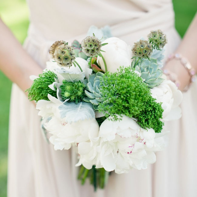 Scabiosa pods, peonies and succulents made up the bridesmaid bouquets at the ceremony.