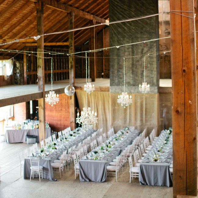 The reception decor included lots of hanging chandeliers and long tables.