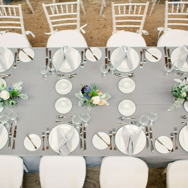 Tables were set with gray linens and streamlined, white dishes and chairs.