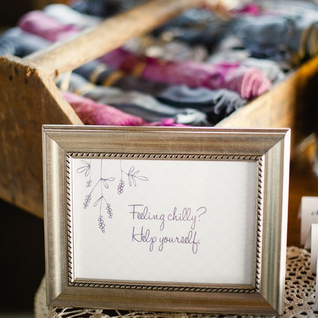 Guests could grab these warm scarves to heat up during the outdoor ceremony and barn reception.