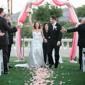 Pink Fabric-Draped Wedding Arch