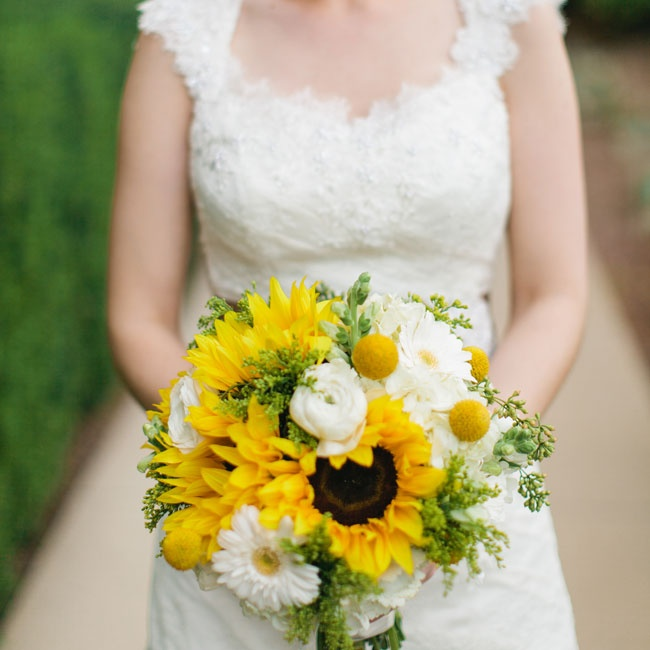 Chelsey's bridal bouquet was a mix of sunflowers, billy balls, ranunculuses and daisies in cheerful yellow hues.