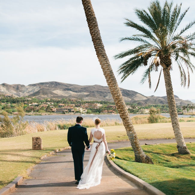 Chelsey wore an elegant sheath gown with lace overlay and open back for a romantic, feminine look. A long clay sash was tied at the dress's natural waist to complete the outfit.