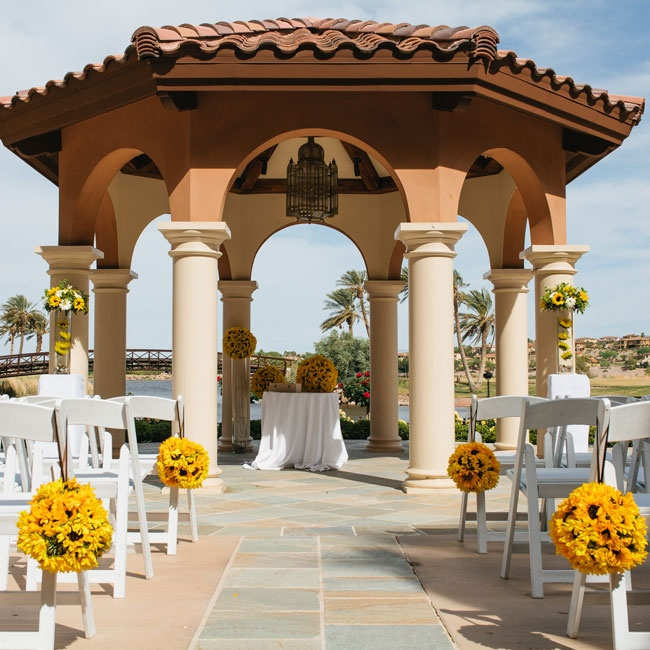 The ceremony took place in the Andalusian Gardens at the West Lake Las Vegas. The couple exchanged vows under an elegant Spanish style gazebo overlooking Lake Las Vegas and blossoming rose gardens.