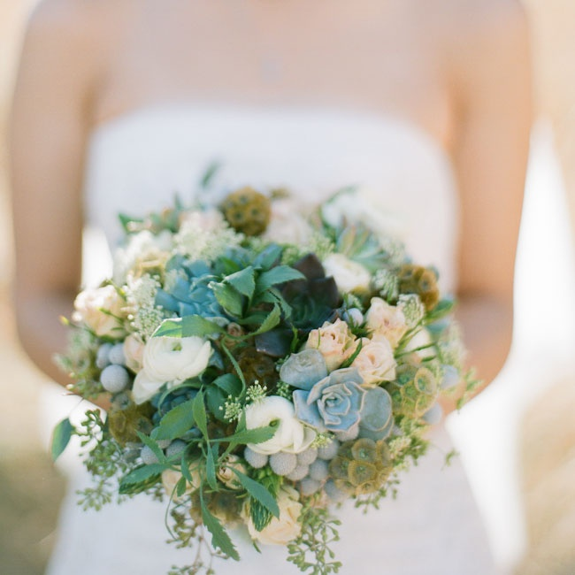 Jo's bouquet played off the muted desert hues, mixing ranunculuses, succulents, roses, berzelias and scabiosa pods in a neutral palette for a rustic, yet feminine vibe.