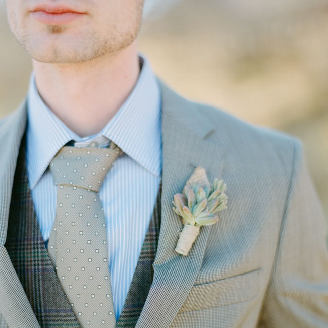 Brett's succulent and burlap boutonniere was inspired by the wedding's natural locale and perfectly complemented the neutral shades of Brett's look.