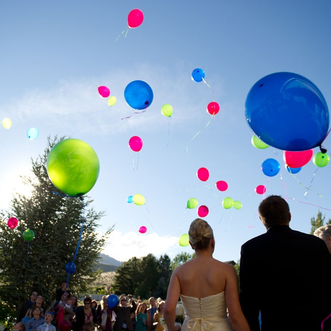 After the ceremony, guests released colorful pink, green and blue balloons into the air.