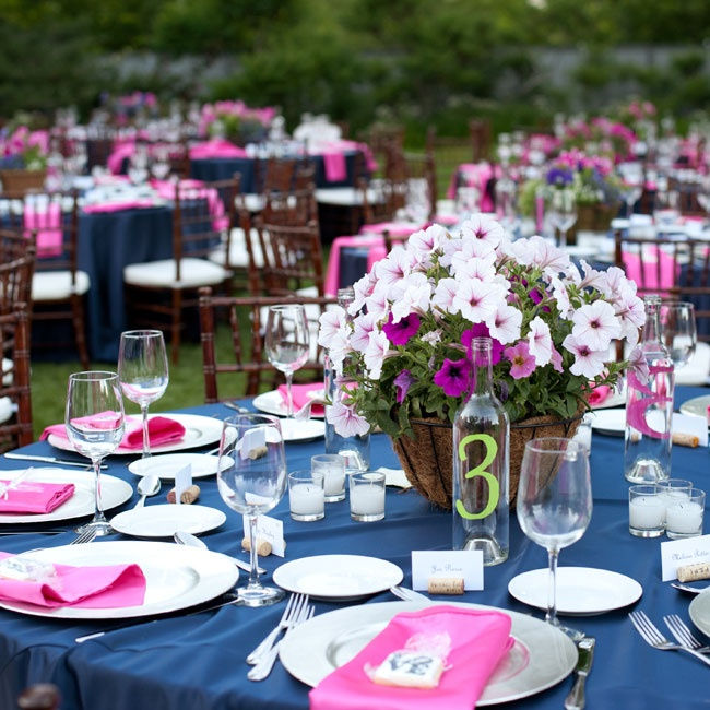 Tables at the reception were set with navy blue tablecloths, pink napkins and silver chargers.
