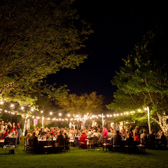 The outdoor reception premises were outlined with bistro lighting.