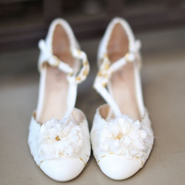 The bride wore these T-strap floral pumps down the aisle on her wedding day.