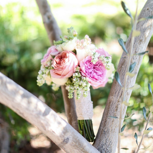 All of the flowers for the wedding were arranged by hand by the bride and her family. Her bridal bouquet was filled with pink roses and peonies.