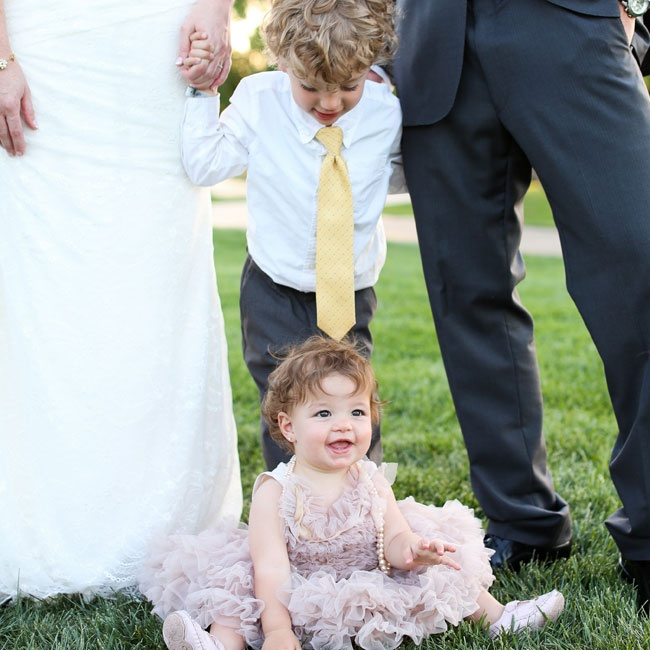 Young relatives of the bride and groom were included in the ceremony with roles as the flower girl and ring bearer.
