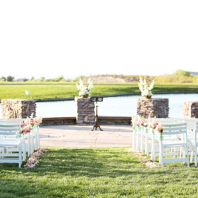 The bride and groom exchanged vows outdoors in a simple ceremony.