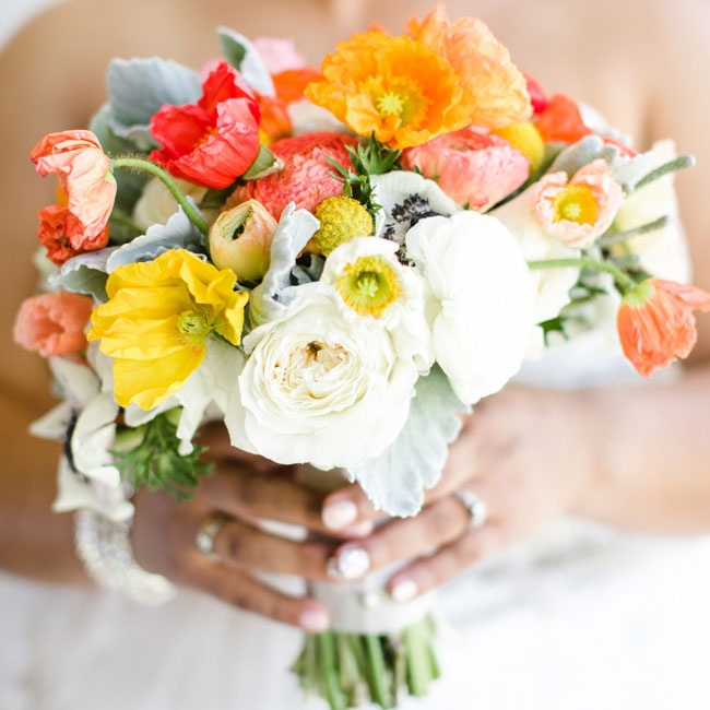 Emily used red and orange poppies and white roses along with billy balls and lamb's ear in her bouquet.