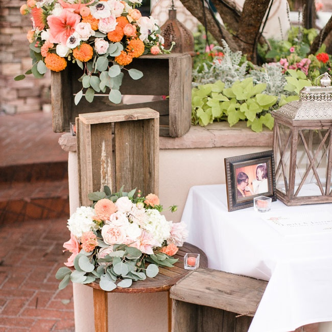 At the reception, distressed wooden crates mixed with family photos and lanterns made for rustic decor.