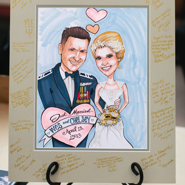 In addition to a traditional guestbook, the couple also invited guests to leave their well wishes on a fun caricature sign-in board.