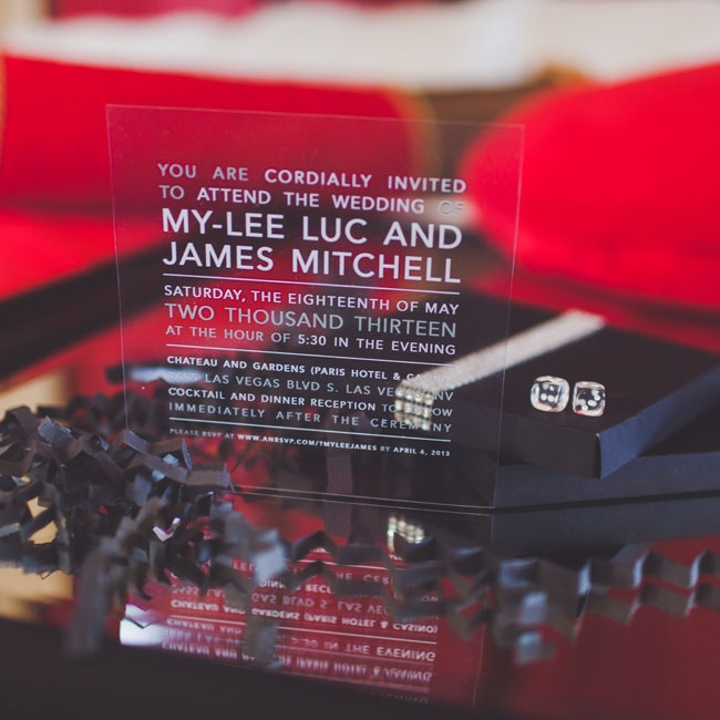 Prior to the wedding, guests received creative invitations that mirrored the location of the wedding. The invites were printed on lucite, came in a black box with a crystal detailing around it and included a pair of dice.