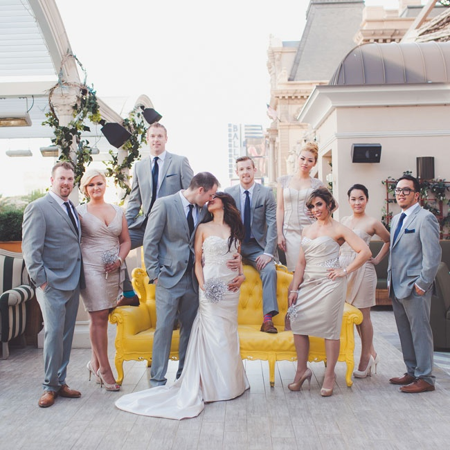 The bridesmaids all wore knee length champagne colored dresses in varying styles and the groomsmen all matched the groom in wearing the same gray suits, pocket squares and ties.