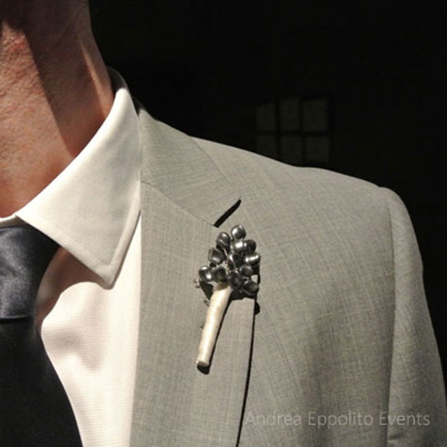 James pinned a simple gray boutonniere made out of pressed pearls onto his lapel.