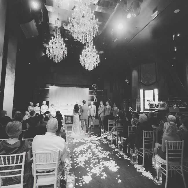 The couple exchanged vows in the nightclub turned reception hall. The decor was kept to a minimum and without the addition of a traditional style altar, creating a relaxed and intimate atmosphere.