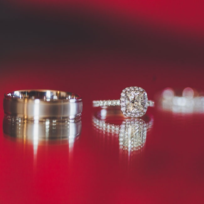 After exchanging vows, My-Lee and James exchanged wedding rings as well. My-Lee's engagement ring was a gorgeous princess cut diamond with a cushion halo and James' wedding band was a classic silver design.