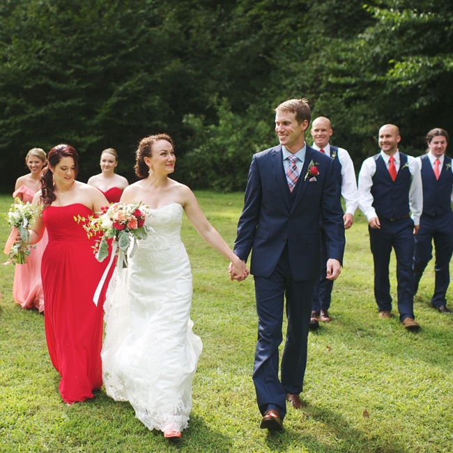 Jessica wore a James Clifford strapless gown that featured stunning lace embroidery and a sweetheart neckline. Her bridesmaids wore floor length gowns in different styles but in coordinated shades of peach and red from Liz Fields, while Dan's groomsmen wore ties in similar shades and looked dapper in vests instead of suit jackets.