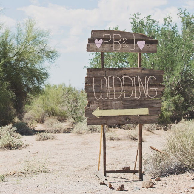Guests were greeted by a rustic, hand-painted wooden sign.