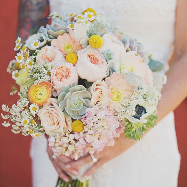 Jessica carried a beautiful, rustic bouquet in pastel hues. The bouquet balanced traditional blooms like peonies, roses and hydrangeas with wildflowers like daisies, queen anne's lace, billy balls and succulents for a unique look.