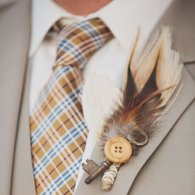 Paul's unique boutonniere was composed of feathers, an antique key and wooden button with burlap and twine accents.