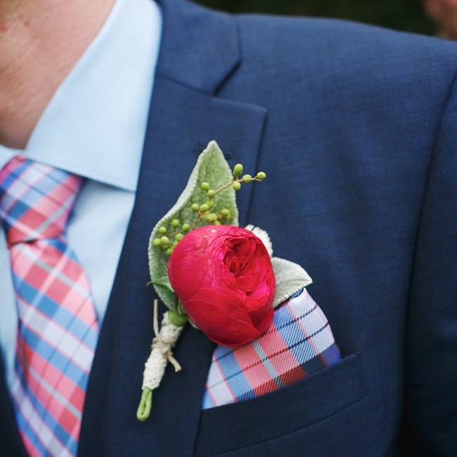 The groom wore a bright red peony boutonniere that was held together with a simple lace wrap and tied with twine to create a rustic look.