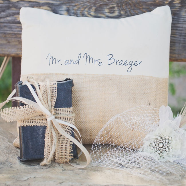 The rings were carried down the aisle on a black, vintage book tied with burlap ribbon.