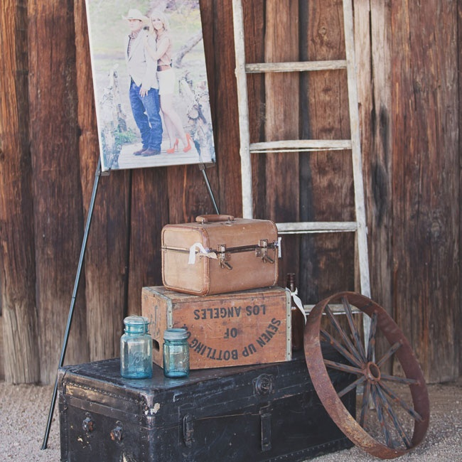 Antique props and blue mason jars decorated the reception entrance for a rustic, vintage look.