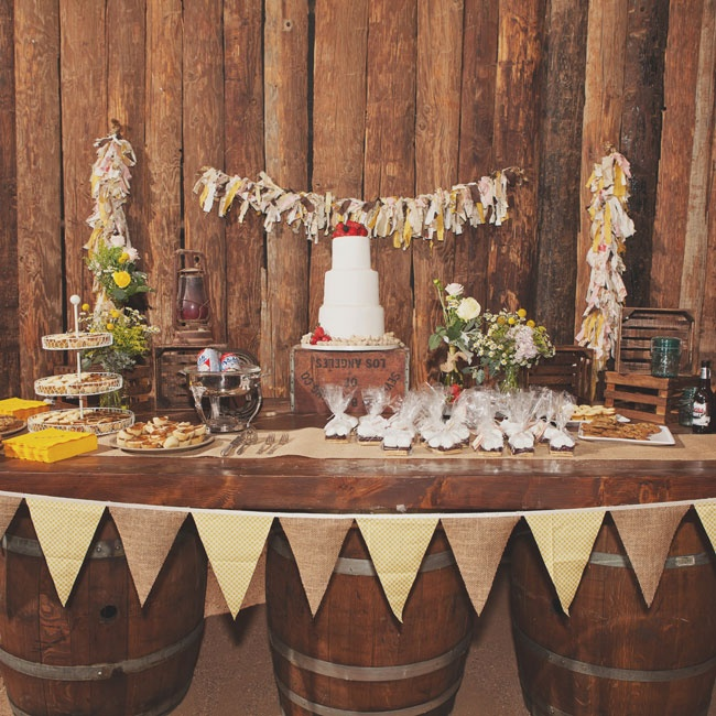 Wine barrels, bunting, wooden crates and scrap fabric bunting gave the dessert table a rustic feel.
