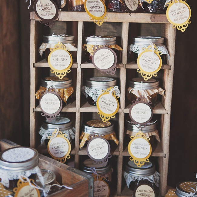 The couple made jars of moonshine with fruit for the favors, which they put into individual jars with fun gift tags and patterned fabric squares.