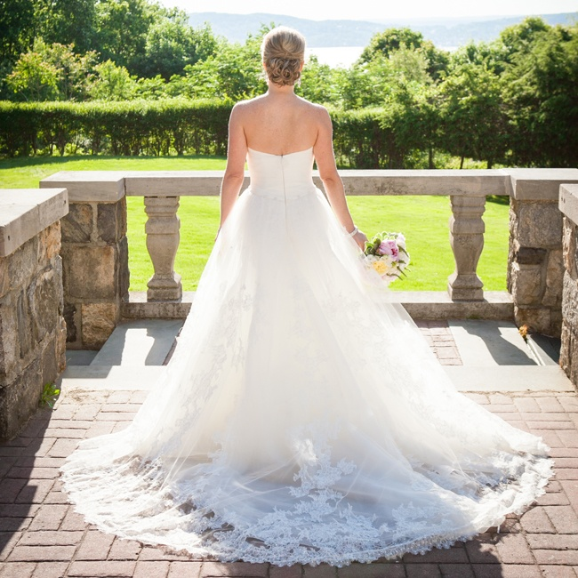 Lindsay wore a beautiful Pronovias A-line wedding gown with lace detailing on the train and throughout the skirt.
