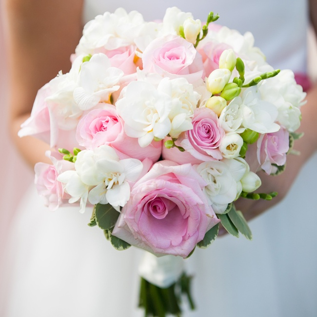 Lindsay's bridal bouquet was girly and sweet with pale pink roses and white hydrangeas.